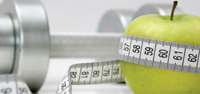 picture of apple and weights representing health